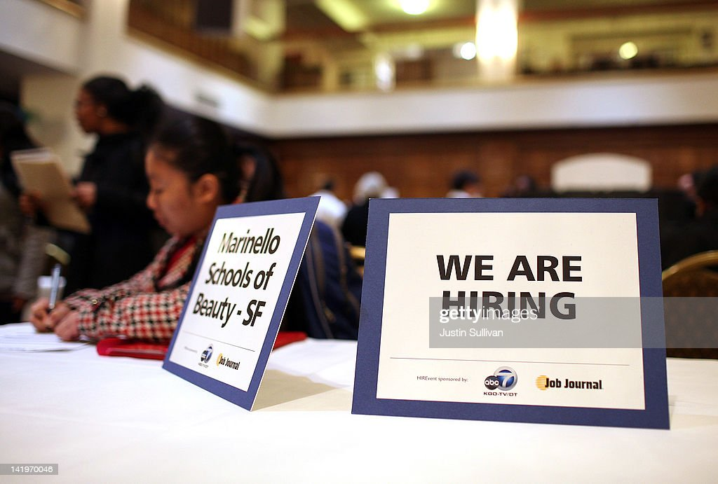 A 'we are hiring' sign is displayed on a table during the San Francisco Hirevent job fair at the Hotel Whitcomb on March 27, 2012 in San Francisco, California. As the national unemployment rate stands at 8.3 percent, job seekers turned out to meet with recruiters at the San Francisco Hirevent job fair where hundreds of jobs were available.