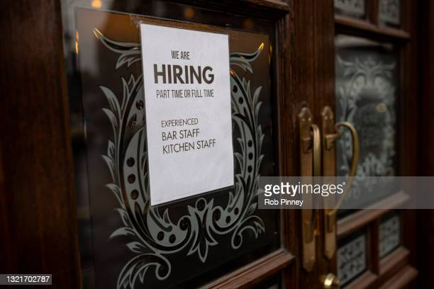 """We are hiring"""" sign is seen in the window of a pub seeking bar and kitchen staff in Westminster on June 04, 2021 in London, England. Demand for..."""