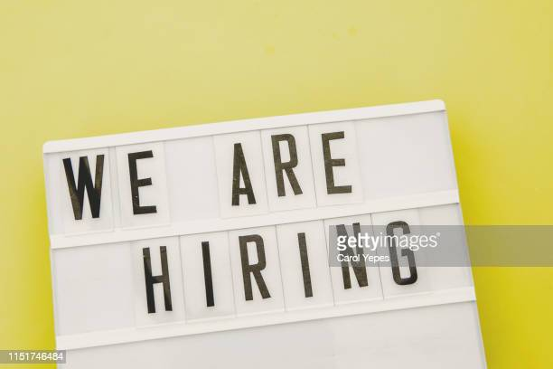 we are hiring text in  lightbox. yellow background - job search stock pictures, royalty-free photos & images
