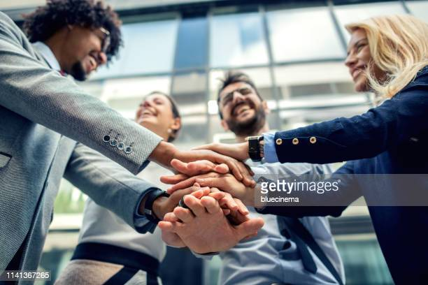 we are one great team - business relationship stock pictures, royalty-free photos & images