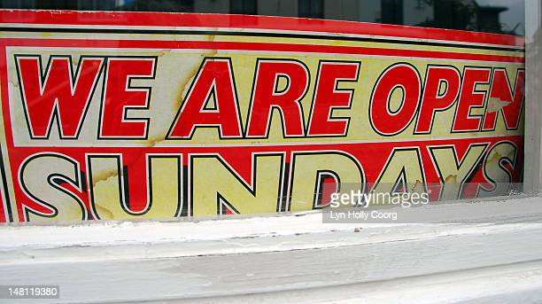'we are open sundays', old sign in a window - lyn holly coorg stock photos and pictures