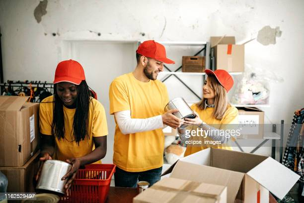 we are team of charitable people - altruism stock pictures, royalty-free photos & images