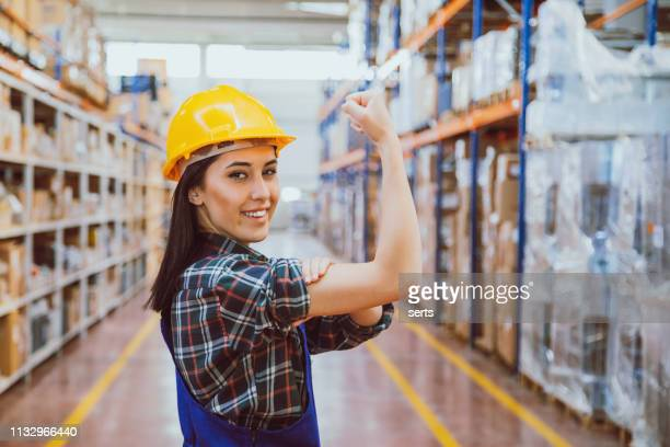 We can do it - Powerful young industrial worker woman in a success pose