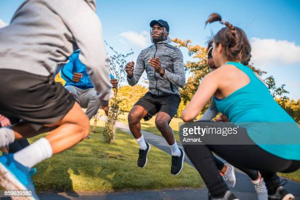 we can jump higher - circuit training stock photos and pictures