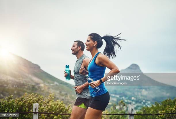 we compete in a friendly way - jogging stock pictures, royalty-free photos & images