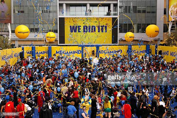 'We Did It' sign and confetti streamers commemorate the setting of the Guinness World Record for the Largest Gathering of Superheroes at the...