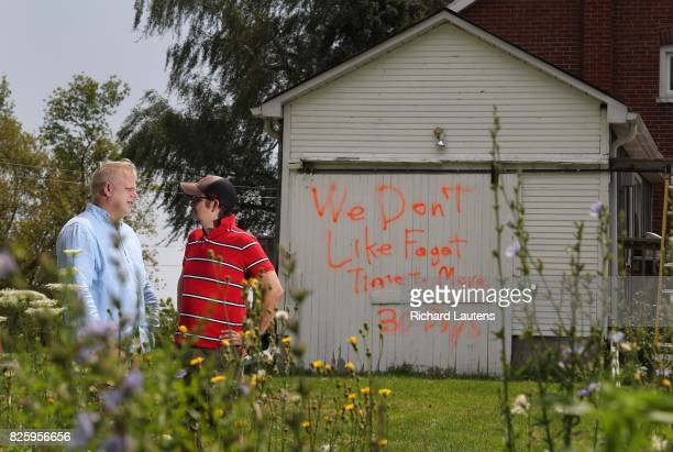 PICKERING ON AUGUST 2 'We don't like fagots 30 days Time to move' Paul AlfordJones and his husband Brett AlfordJones found this homophobic graffiti...