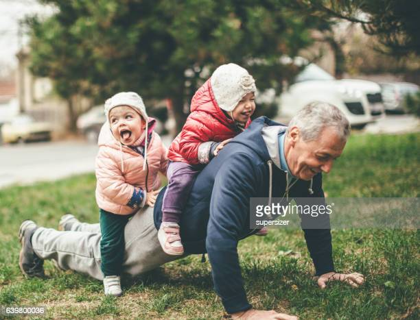 we exercise togather - multigenerational family stock photos and pictures