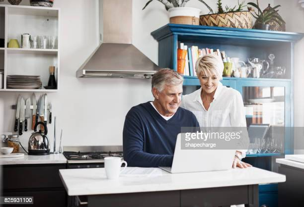 we get our news both online and offline - mature couple stock pictures, royalty-free photos & images