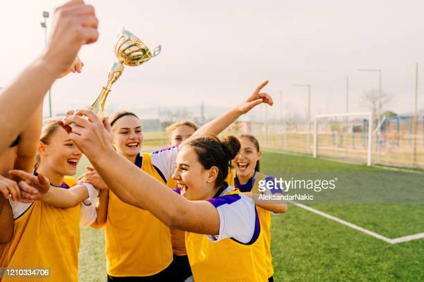 we got our trophy! - holding trophy stock pictures, royalty-free photos & images