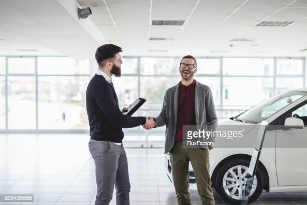 we have an agreement - car salesperson stock pictures, royalty-free photos & images