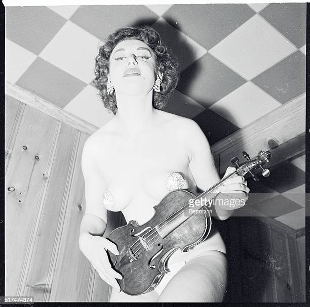 We know that every stripper has one 'Gstring' but Paula Uhsan has two there's a Gstring on her violin an integral part of her strip act Paula Uhsan...