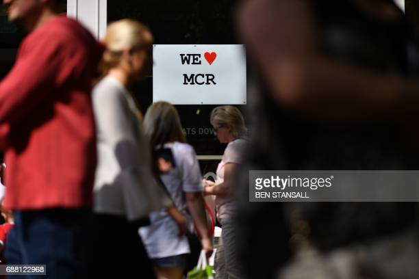 A We Love MCR sign is seen in central Manchester northwest England on May 25 as a mark of respect to the victims of the May 22 terror attack at the...