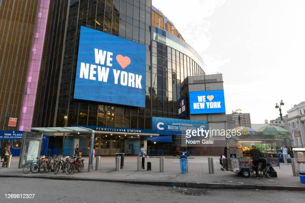 A 'we love New York' is displayed on a billboard outside the Madison Square Garden as the city continues Phase 4 of reopening following restrictions...