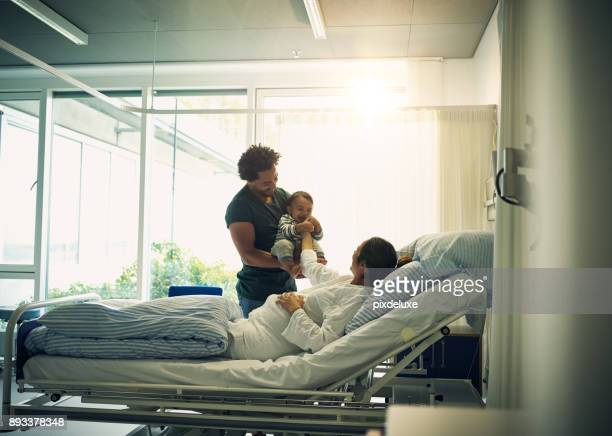 we love our firstborn so much - hospital room stock photos and pictures