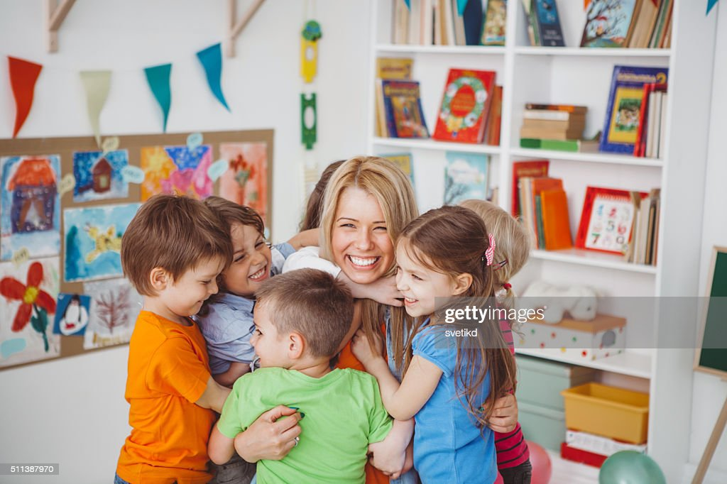 We love our teacher : Stock Photo