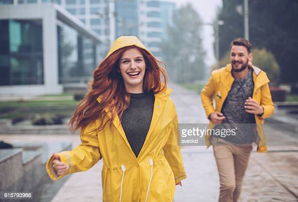 we love rainy days - raincoat stock photos and pictures