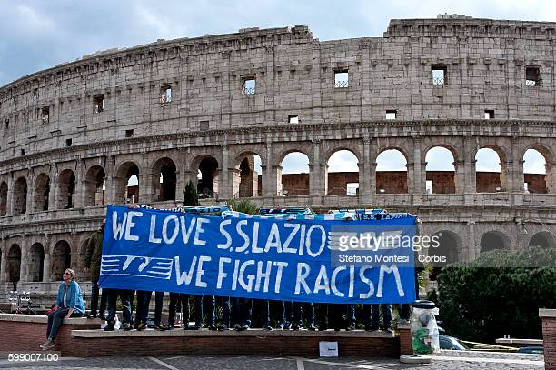 """""""We Love S.S. Lazio 1900 - We Fight Racism"""". A group of Lazio fans staged a flash mob at the Colosseum on Thursday to show that not all supporters of..."""