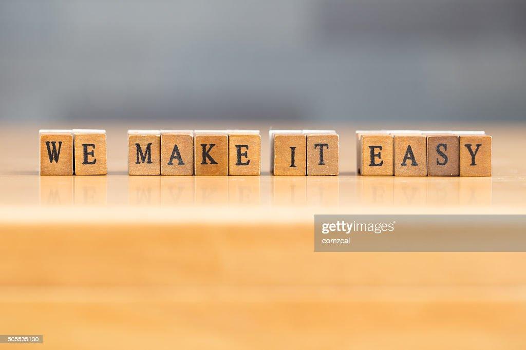 We make it easy. word written on wood block : Stock Photo