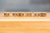 We make it easy. word written on wood block