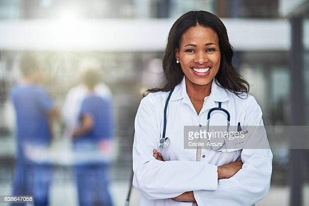 we offer our patients premium healthcare here - female doctor stock photos and pictures