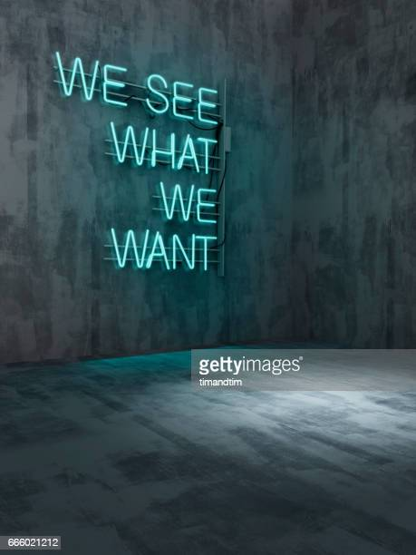 we see what we want neon in an empty room - neon letters stock photos and pictures