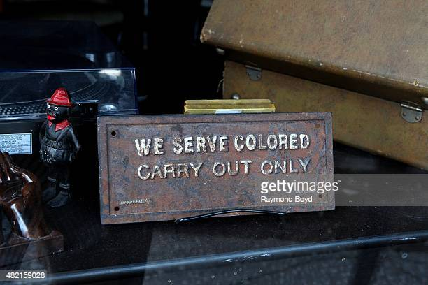 'We Serve Colored Carry Out Only' sign in the window of the Madame C.J. Walker Beauty Shoppe and Museum on July 17, 2015 in Atlanta, Georgia.