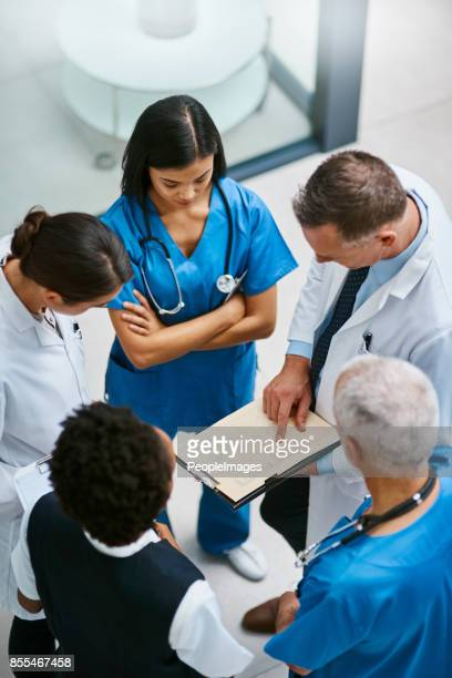 we should be able to discharge this patient soon... - medical team stock photos and pictures