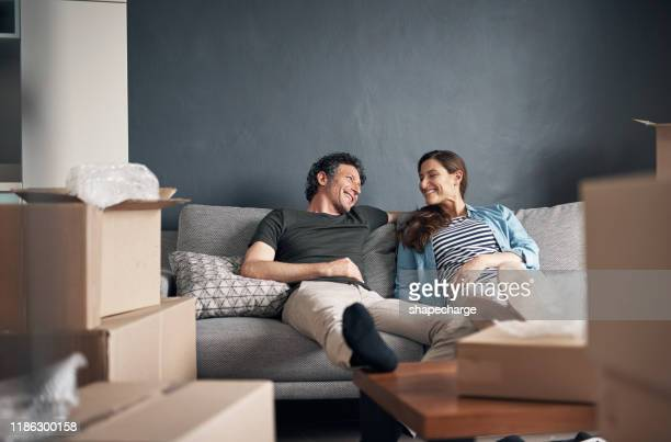 we should get back to packing soon - moving house stock pictures, royalty-free photos & images
