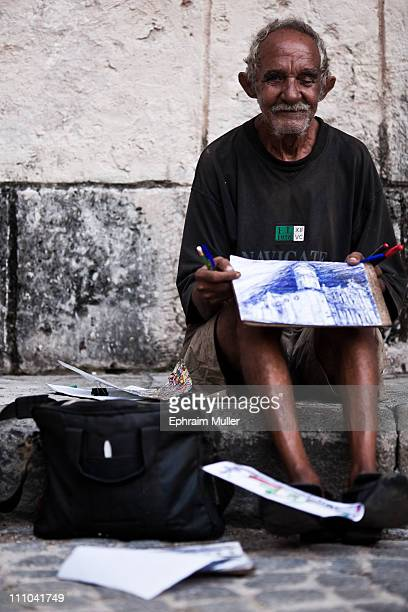We spotted this old legend sketching against the wall of a museum facing the cathedral We gave him the last of our pens we brought with and in return...