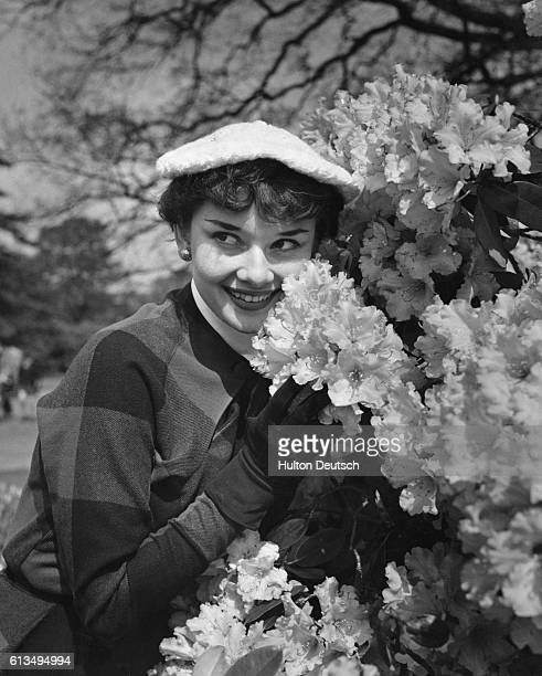 """We Take A Girl To Look For Spring. After many months of rehearsing and appearing in the London revue """"Sauce Piquante"""", Audrey Hepburn finds time to..."""
