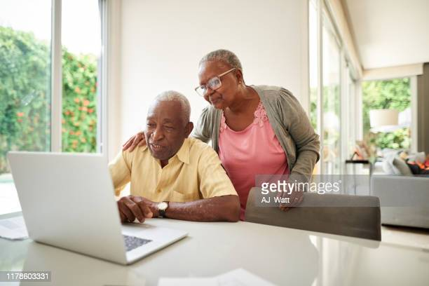 we understand the importance of investing money - senior couple stock pictures, royalty-free photos & images