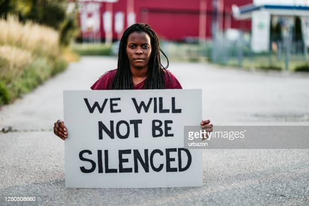 """we will not be silenced"" placard - protest against violence against women stock pictures, royalty-free photos & images"