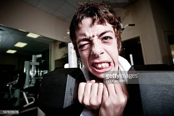 weakling - skinny teen stock photos and pictures