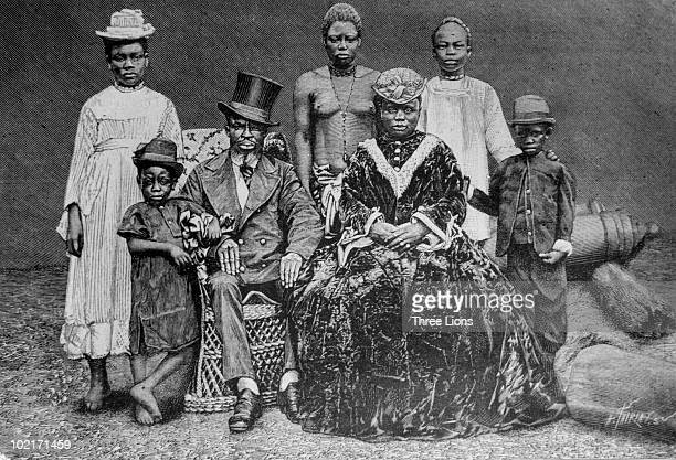 A wealthy African family in PortoNovo Dahomey 1900 The family is dressed in a mixture of western and traditional styles Photo by Three Lions/Hulton...