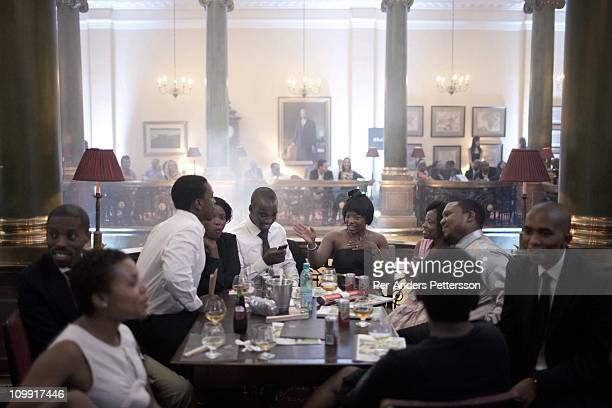 Wealthy black South Africans wait for the KLuK CGDT label fashion show at the Rand Club at Joburg Fashion Week on February 16 in Johannesburg South...