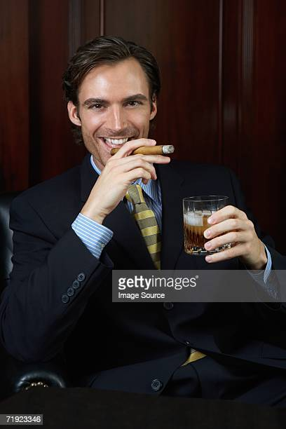wealthy businessman - smug stock photos and pictures