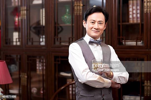 Wealthy businessman with wine