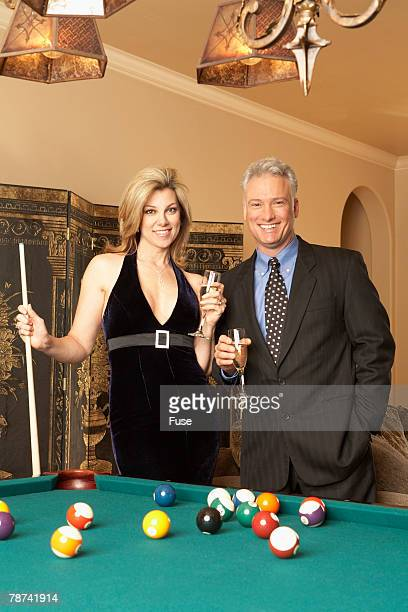 Wealthy Couple at Pool Table