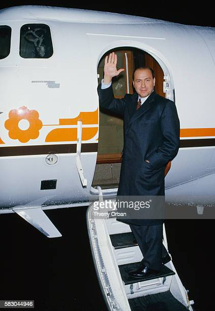 Wealthy Italian businessman Silvio Berlusconi boards his private plane before leaving Paris for Milan In 1994 Berlusconi served briefly as Italian...