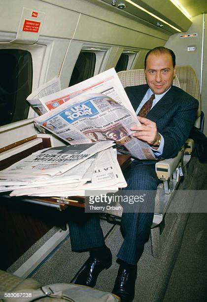 Wealthy Italian businessman Silvio Berlusconi reads newspapers aboard his private plane while leaving Paris for Milan In 1994 Berlusconi served...