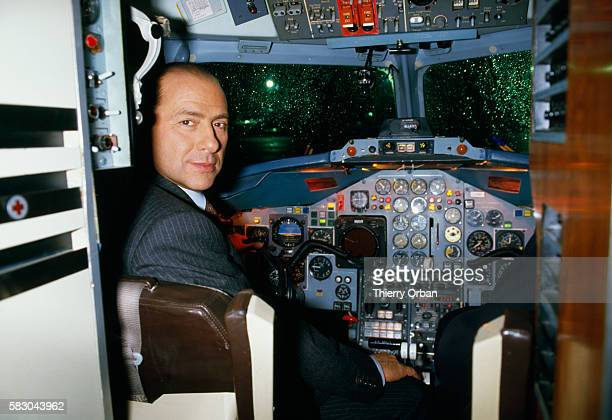Wealthy Italian businessman Silvio Berlusconi sits in the cockpit of his private plane before leave Paris for Milan In 1994 Berlusconi served briefly...