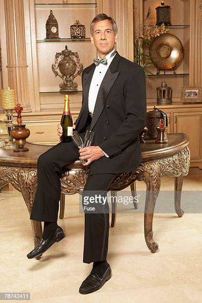 Wealthy Man With Champagne and Glasses