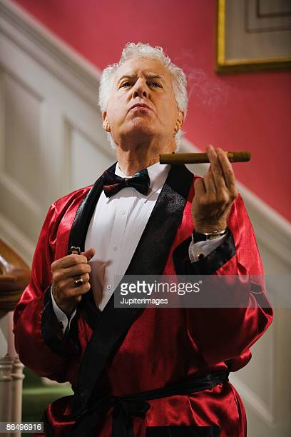 wealthy man with cigar - smoking jacket stock photos and pictures