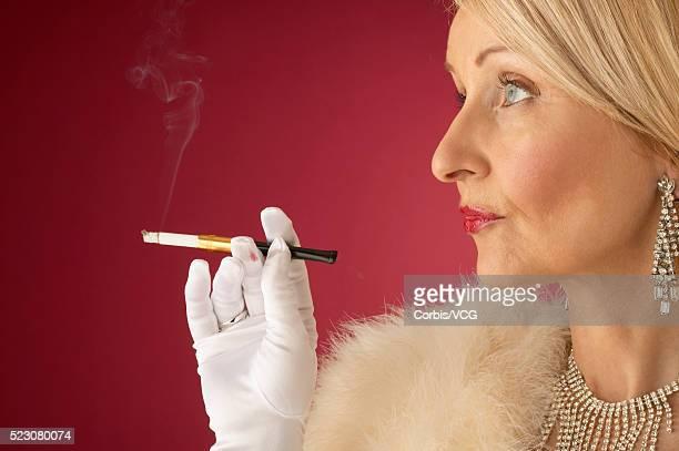 Wealthy Mature Woman Smoking Cigarette