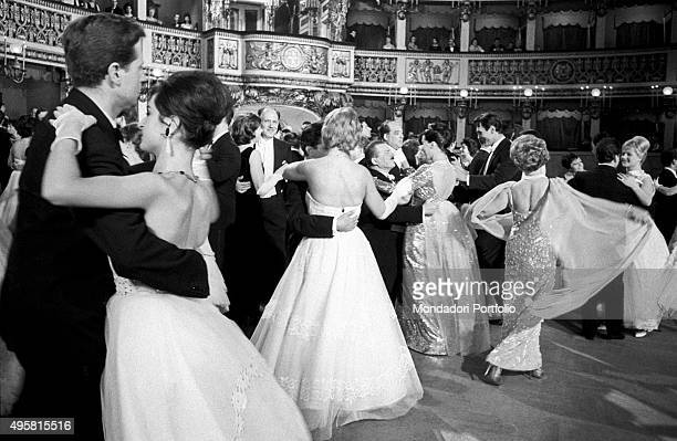 Wealthy people and celebrities dancing a waltz at the San Carlo Theater in the final sequence of The Final Judgement in the middle of the arena among...