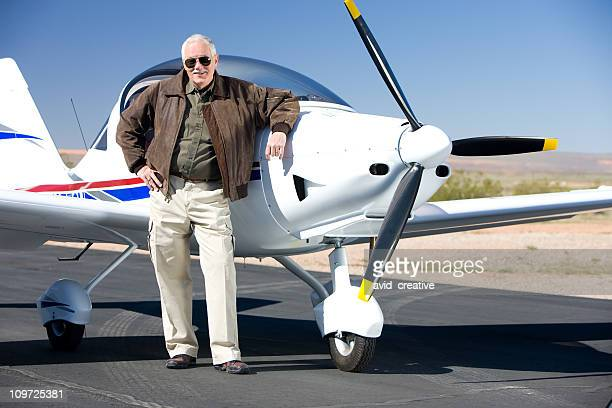 wealthy pilot with modern prop aircraft - bomber jacket stock pictures, royalty-free photos & images