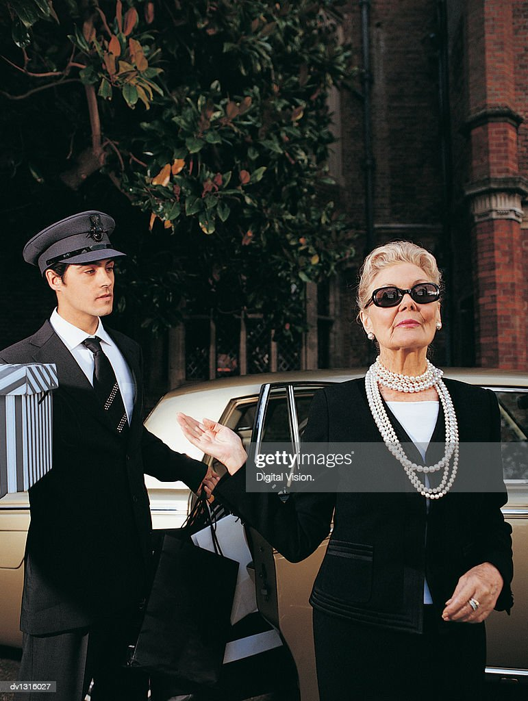 Wealthy Senior Woman in Front of Her Car and Chauffeur : Stock Photo