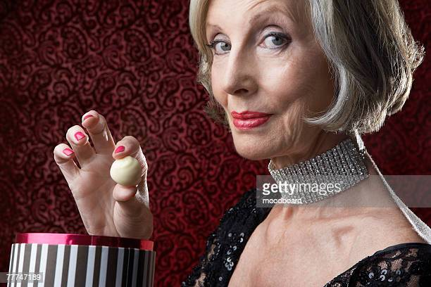 Wealthy Senior Woman with Candy