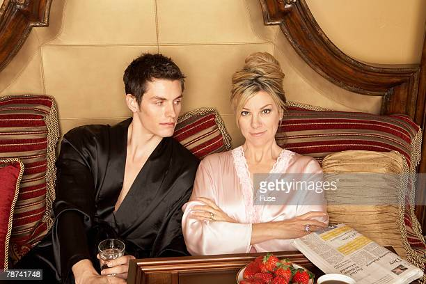 Wealthy Woman and Teenage Boy in Bed